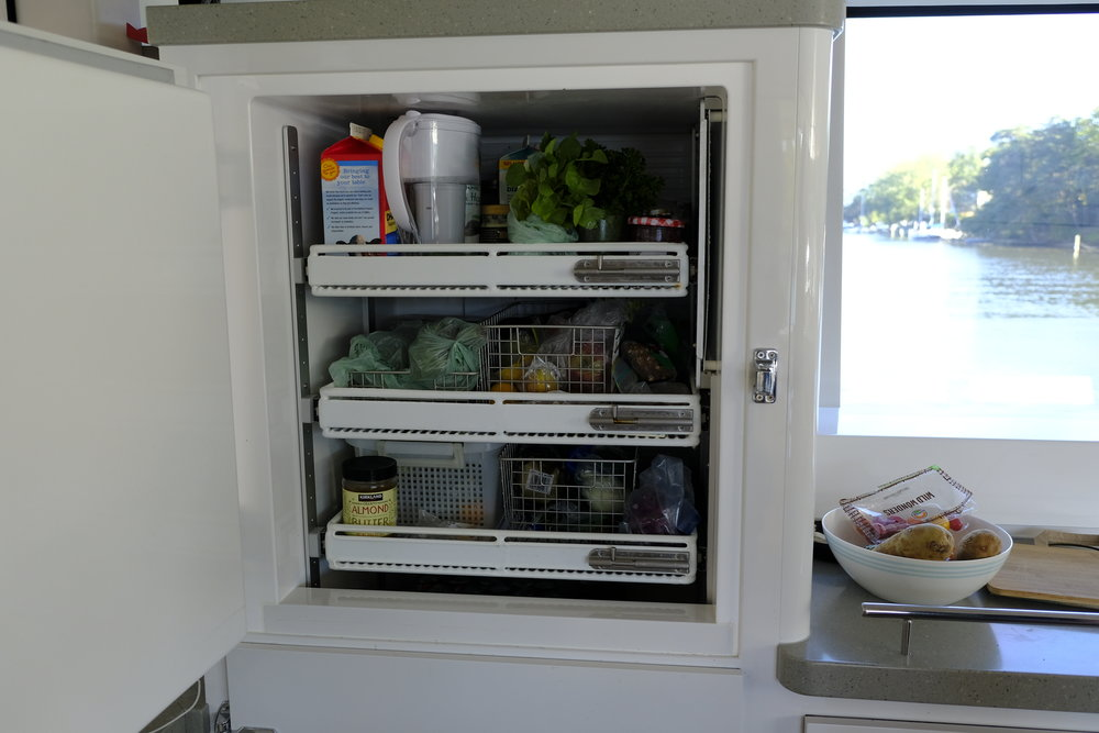 The two refrigerators have sliding shelves that can be adjusted in height, and locked into place under way. This is the best arrangement I have seen on a boat with side access.