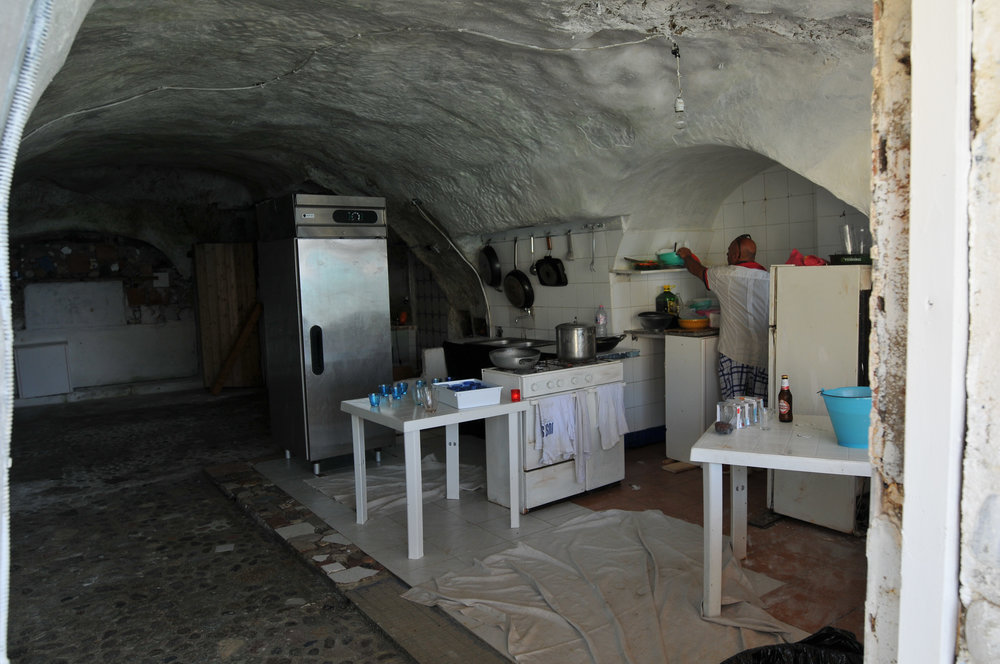 Cave kitchen that works. Note the tile. No slack here. It was a one-item menu with crusty bread, cold beer and red wine. What more could you want?