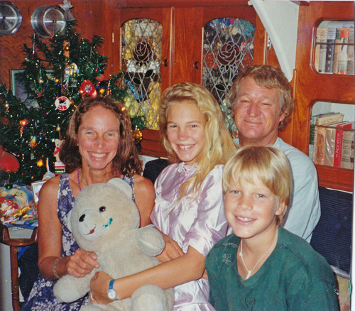 Pam Wall and her family celebrating Christmas in 1990 aboard KANDARIK in South Africa.