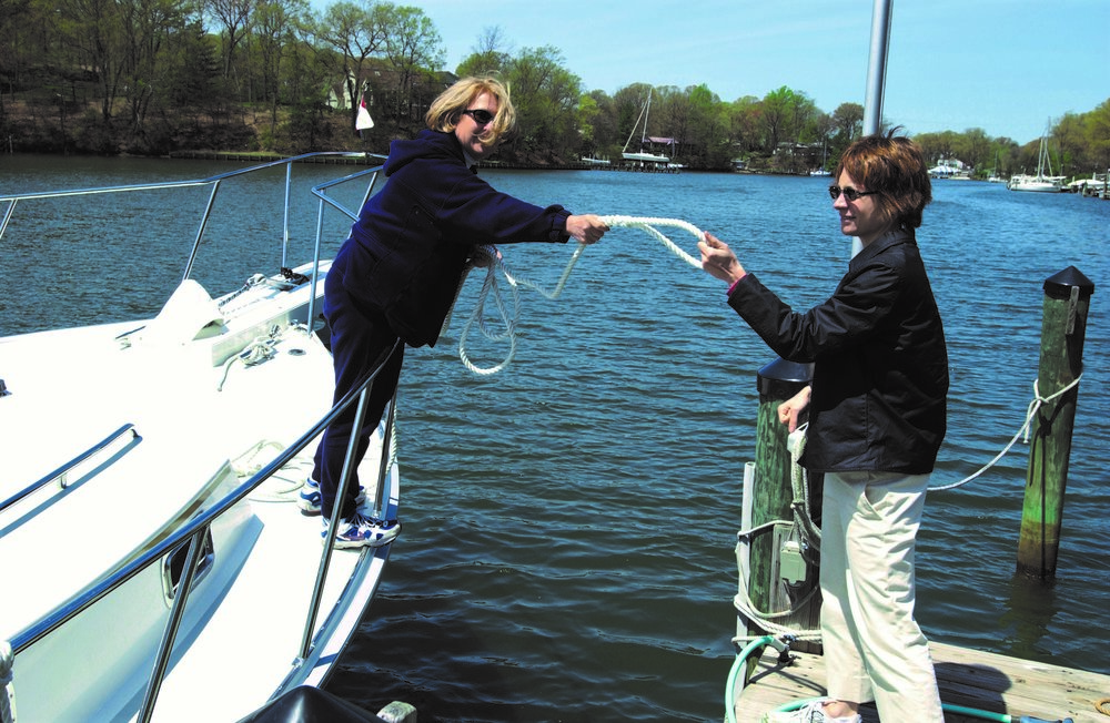 It is a simple matter to hand the loop of the dock line to someone on the dock, asking them to just put it on that cleat. You control the rest from onboard your boat.