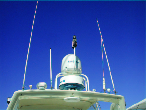 An example of an overall poor installation. The Northstar differential antenna on the right is way too close to the VHF antenna. It should be at least three or four feet away. The small GPS antenna between them is also in the path of the radar beam. On the left side of this photo, the short cellular antenna is mounted too close to the tall outboard VHF antenna.