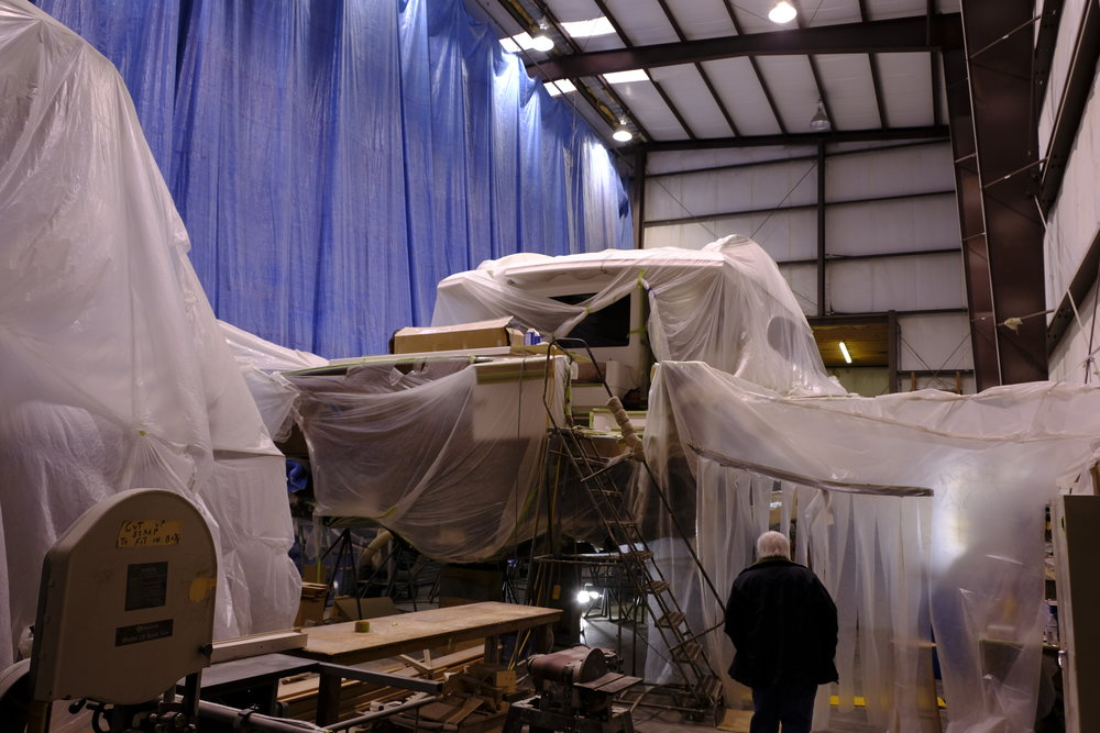 Hard to see behind all of the plastic, but there is a fabulous 74-foot sportfishing yacht front and center in this shed. The flybridge under the plastic to the left was cut off so the engines could be removed out of the top of the boat through a hole cut in the saloon sole. Not for the faint of heart!