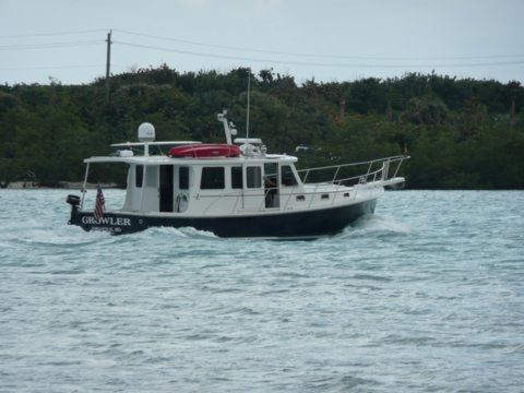 This was taken by a woman aboard a Krogen 42 I just passed. The couple recognized  Growler  and waved to us .