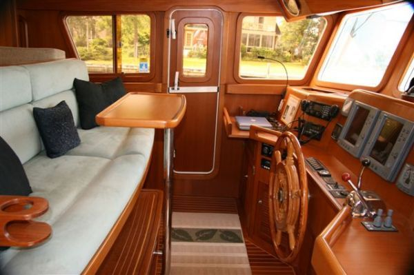 This Selene 48 doesn't have the room in the pilothouse for a dedicated helm chair, but the settee is comfortable and close to the controls. The way Brian likes it.