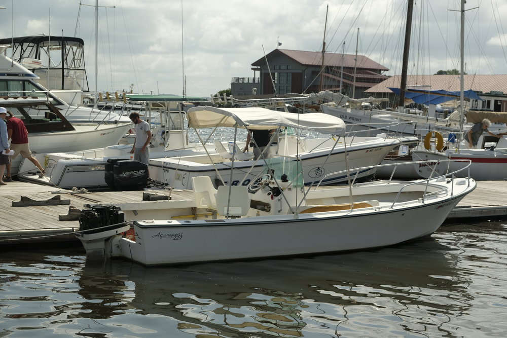 A tired Aquasport 22-foot center console could be a good project for someone.