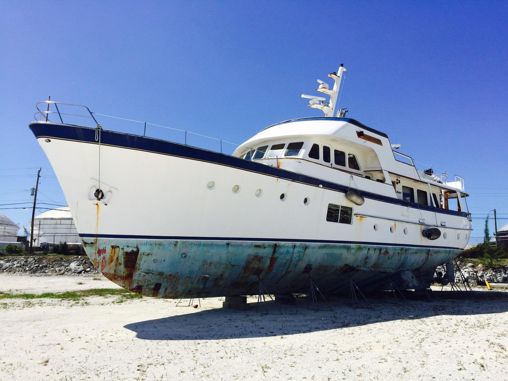 This 1964 Feadship canoe stern motoryacht would make a super home if lowered into the ground to its waterline and connected to city services. Just look at the interior pictures. Its superb interior rivals any million-dollar mansion. Eventually remove engines, tanks, and other nautical elements no longer necessary and one finds even more space for other comforts and accommodations. A 600-bottle wine cellar in the engine room! A unique residence one could be proud of. Keep the anchor for a distinctly nautical touch.