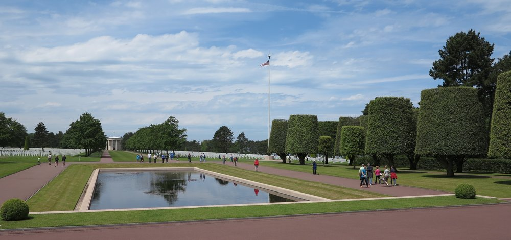 The Normandy American Cemetery in France is a quiet, meticulously maintained memorial that highlights the French reverence for all it represents, and the lives buried here. French school children frequently arrive by bus to lay flowers on individual graves.