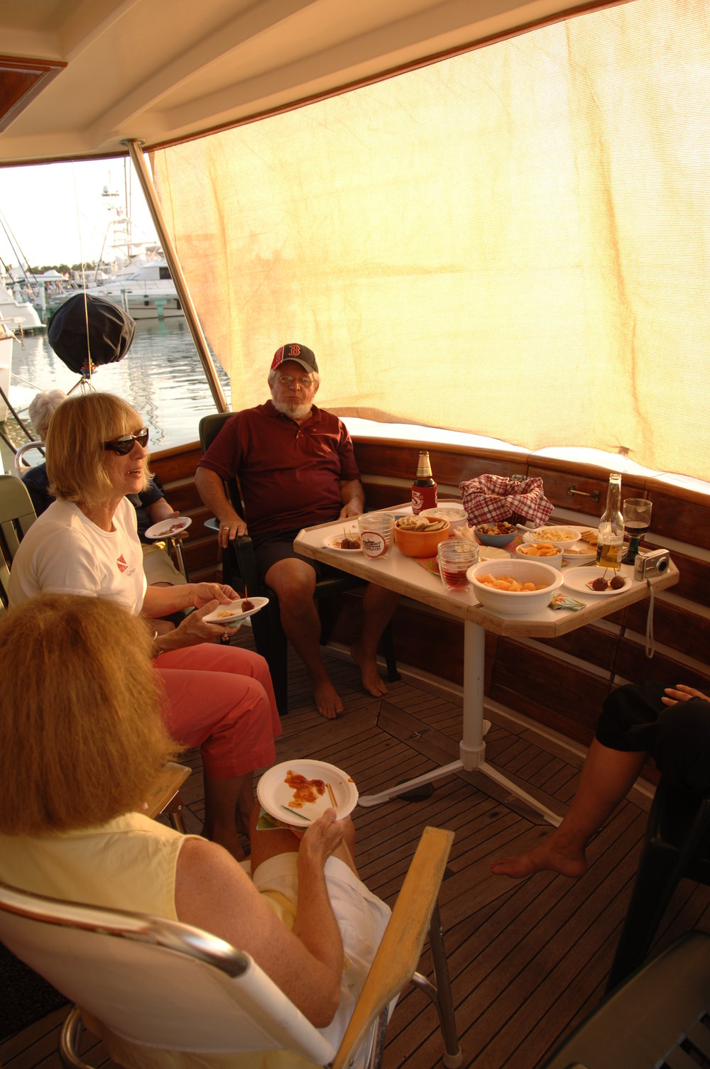 Sundown time aboard this Krogen 42. Everyone brings something to share and their own drink of choice. This is a great way to spend time together and look for the Green Flash.