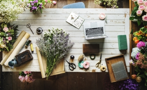 woman-desk-crafts-flowers