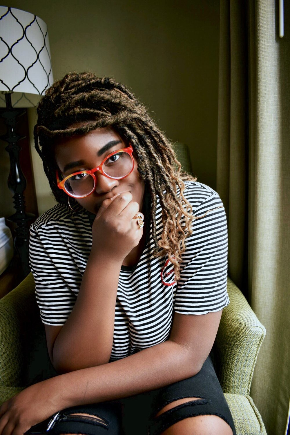 Photographed by Sola Onitiri - Glasses By Firmoo.com