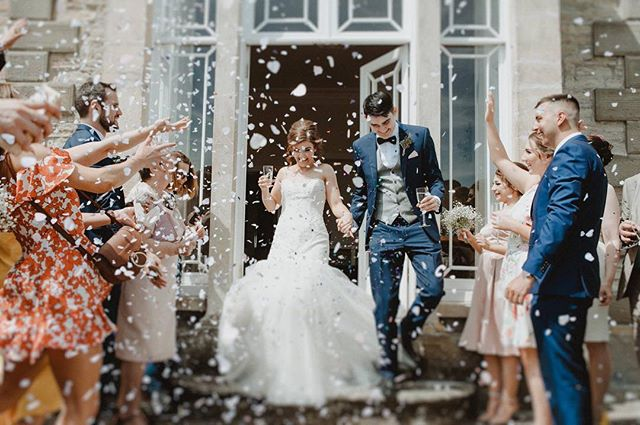 Top notch confetti throwing by Phoebe + Eliot's mates at @sttewdricshouse 🎉😆 Who wouldn't want to get caught up in a confetti flurry?!