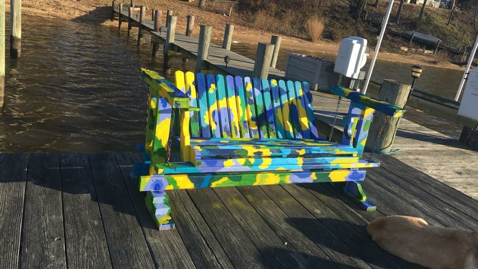 my dog napped in the sun while I painted this swinging bench
