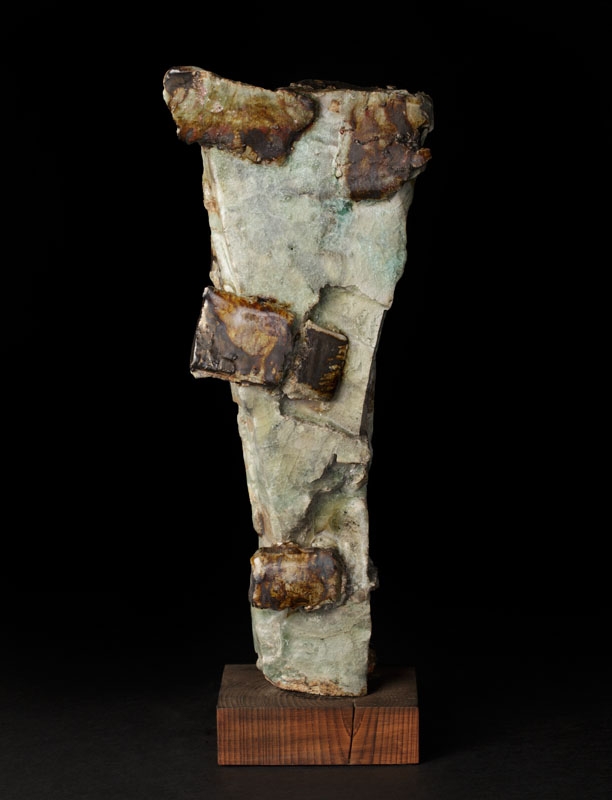 Narrow sculpture with bronze appendages
