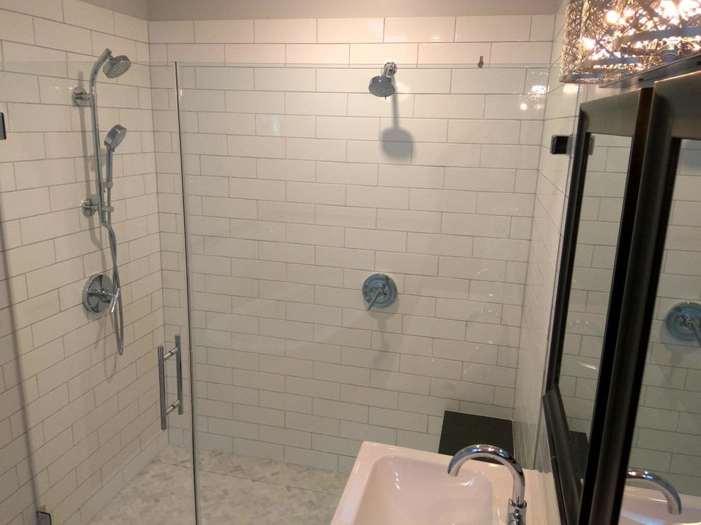 This shower has dual heads, dual controls and a hand shower.