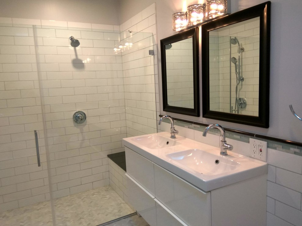 In addition to the can lights in the ceiling, the vanity light adds a little sparkle to the area.