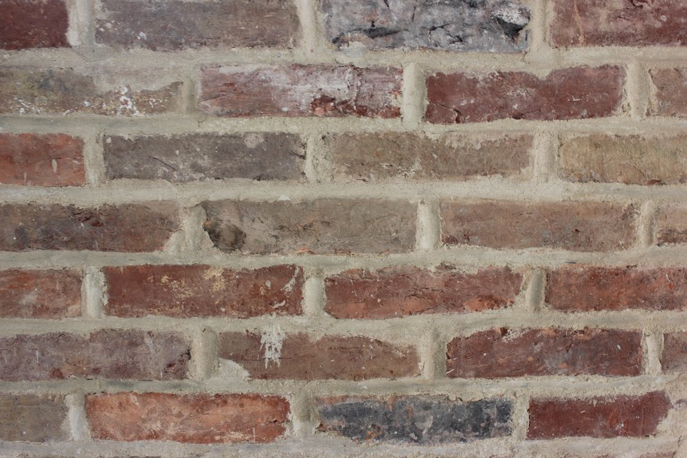 Finished bricks. Set and mortared in facade wall at back of 1st floor of 1608 Barclay St.