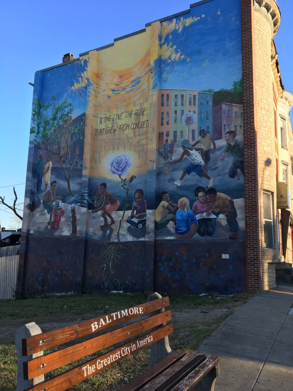 "Local mural in the Barclay neighborhood of Central Baltimore.  ""Long live the rose that grew from concrete."""