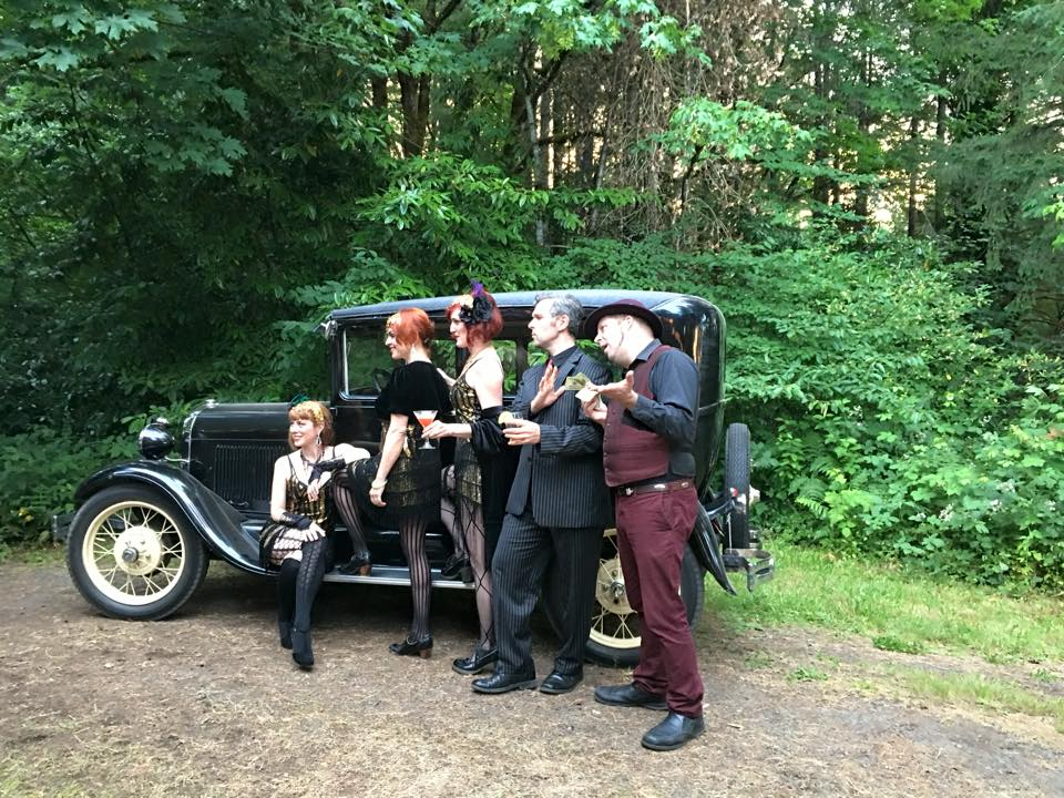 The Libertine Belles posing with the Model A at the annual Dundee Lodge Roaring 20s Party~ a private event.