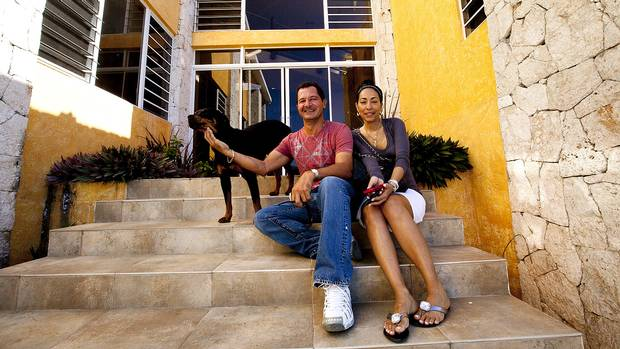 Joel Khawly and wife Sheila Khawly outside the home they built in Jacmel. (Deborah Baic/The Globe and Mail)