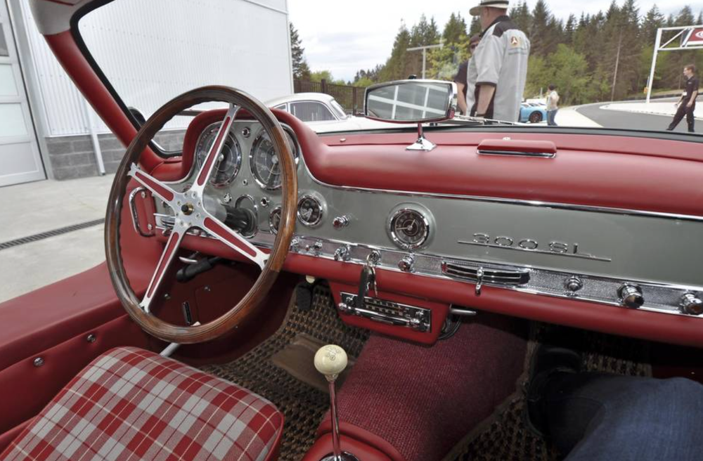 An interior shot of the Koniczek's restored 300SL, which includes a matching luggage set.