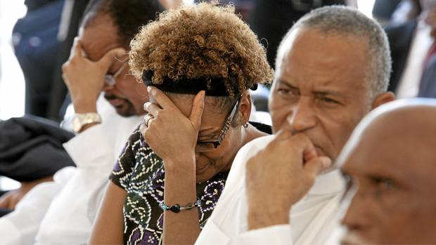 Michaelle Jean, former General Governor and current special envoy to Haiti for UNESCO, reacts as Suzette Prophete tells her harrowing earthquake story at a memorial ceremony at Port-au-Prince's Universite Quisqueya, in Haiti. (Deborah Baic/The Globe and Mail)