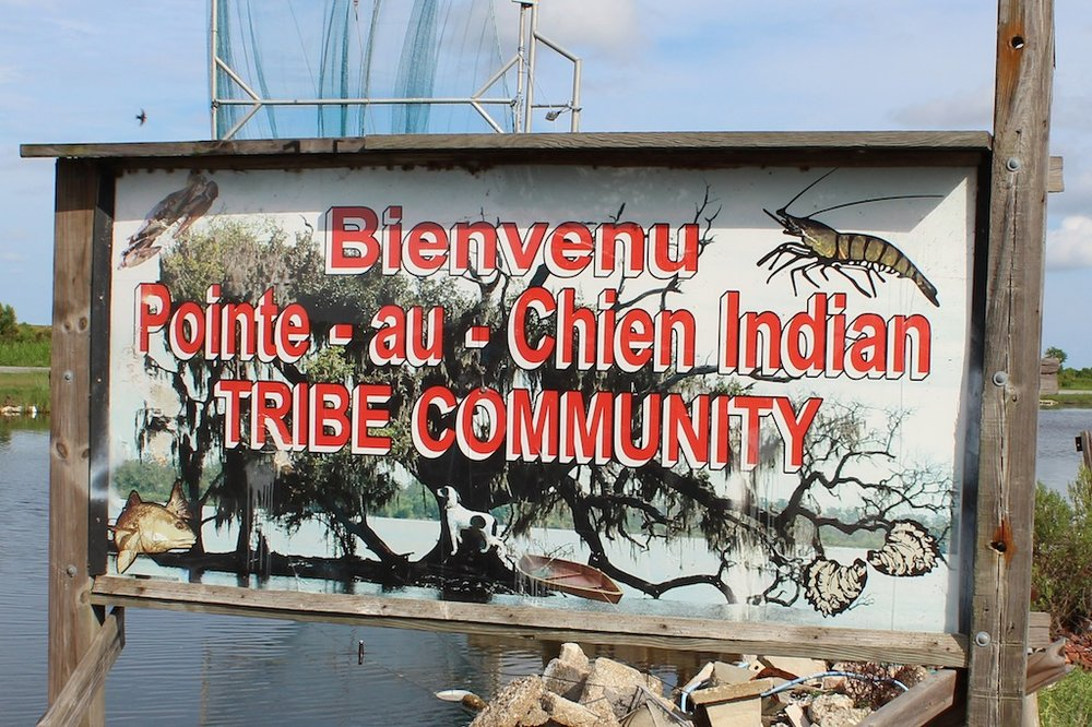 A sign welcoming visitors to Pointe-au-Chien tribal land
