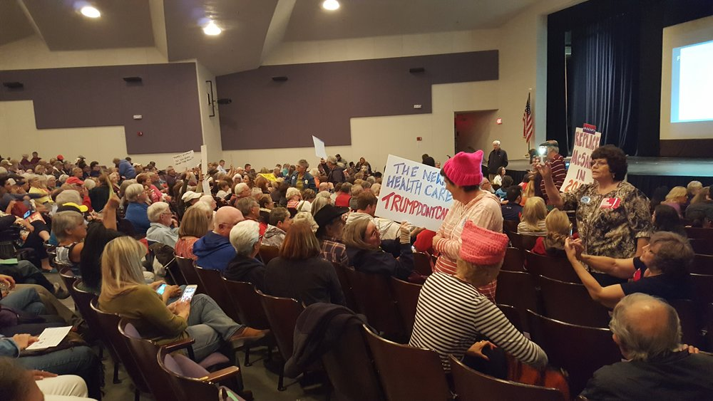 The Rincon High School auditorium, packed with sign-waving citizens.