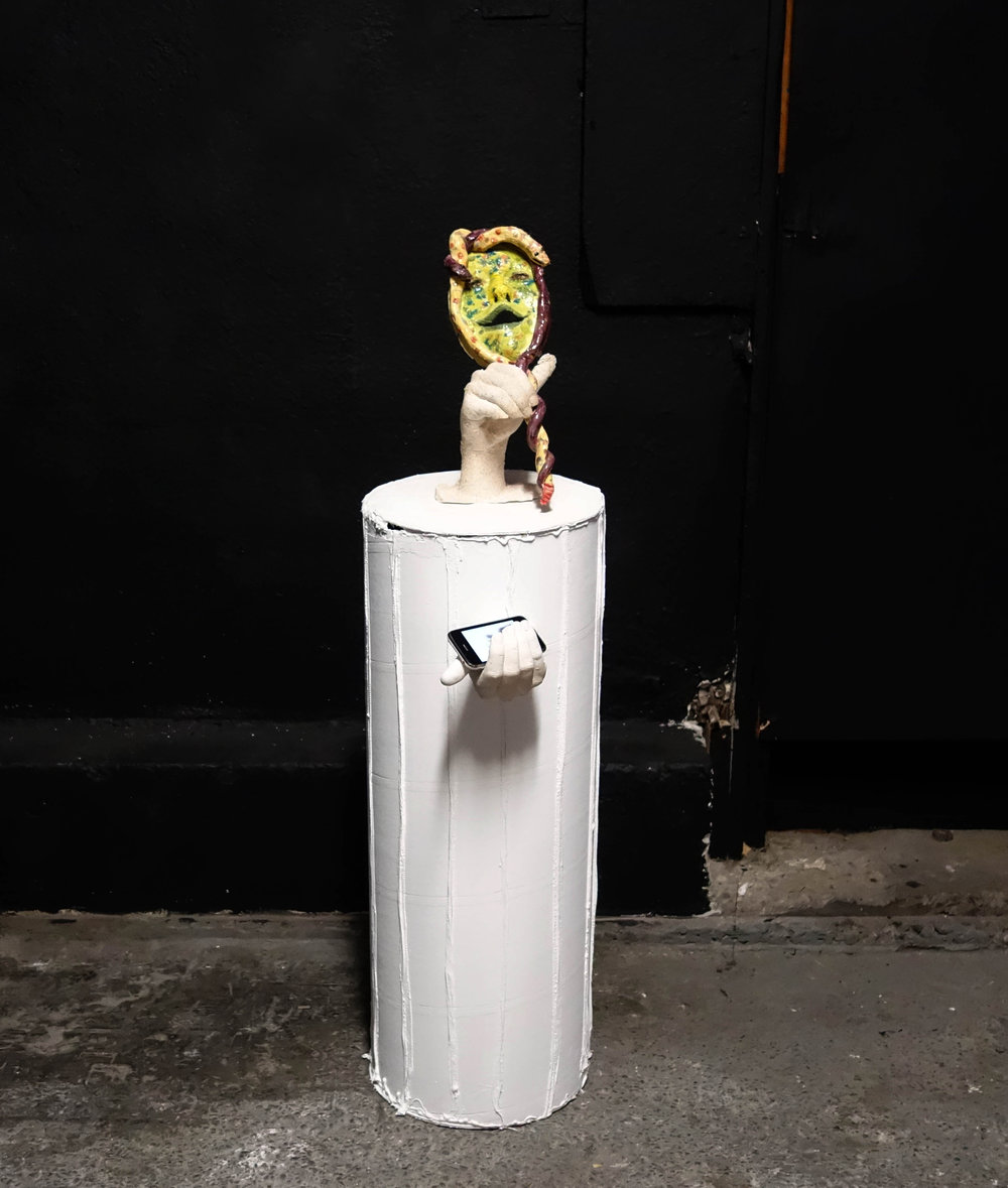 "Molly Shea, ""Perseus is a Dick: Everyone always forgets Medusa gave birth to Pegasus"", 2018. Dimensions variable. Ceramics, quick-tube column & an iPhone 1."