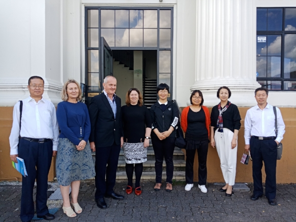 The Leadership Team of GanSu Academy and the FREEDOM Institute of Higher Education gather in front of the Institute's Victoria Campus. In this photo are Dong Jisheng, Melissa Hackell, Graeme Stevenson, Susan Stevenson, Wang Junlian, Cecilia Zhang, Xu Nuo and Gao Yingheng (from left to right)