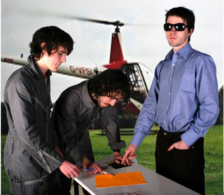 We mocked up this image on MS Paint. Lee being the classic record label head honcho, jumping out of his helicoptor with only enough time for JT & I to sign the 'recording contract' and off he went, back to London.