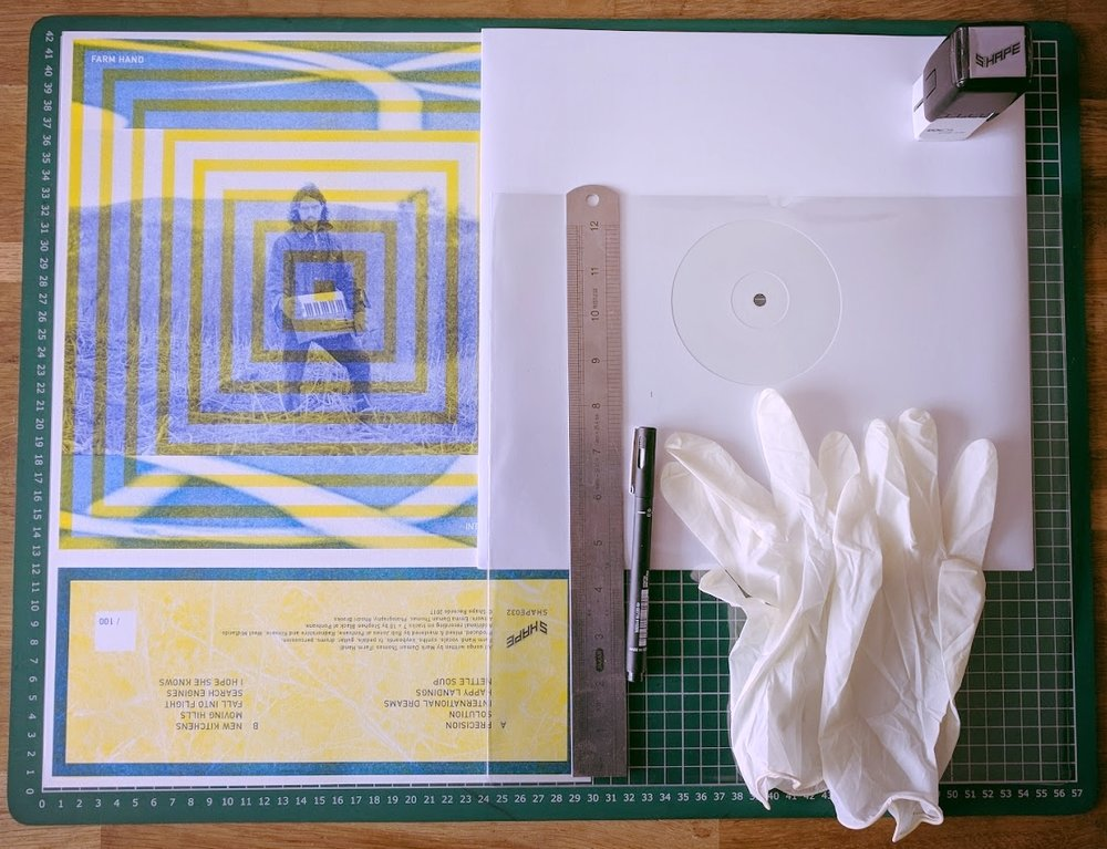 The A3 print, white label record, clear sleeve, Shape stamp and pen, ruler and gloves. Missing from this is the 'A' stamp I put to signify the A side.