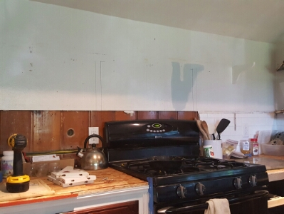 Kitchen missing the stove hood