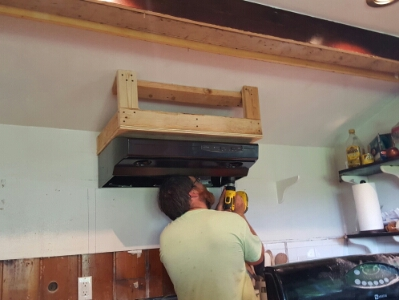 Attaching the stove hood to the support frame.