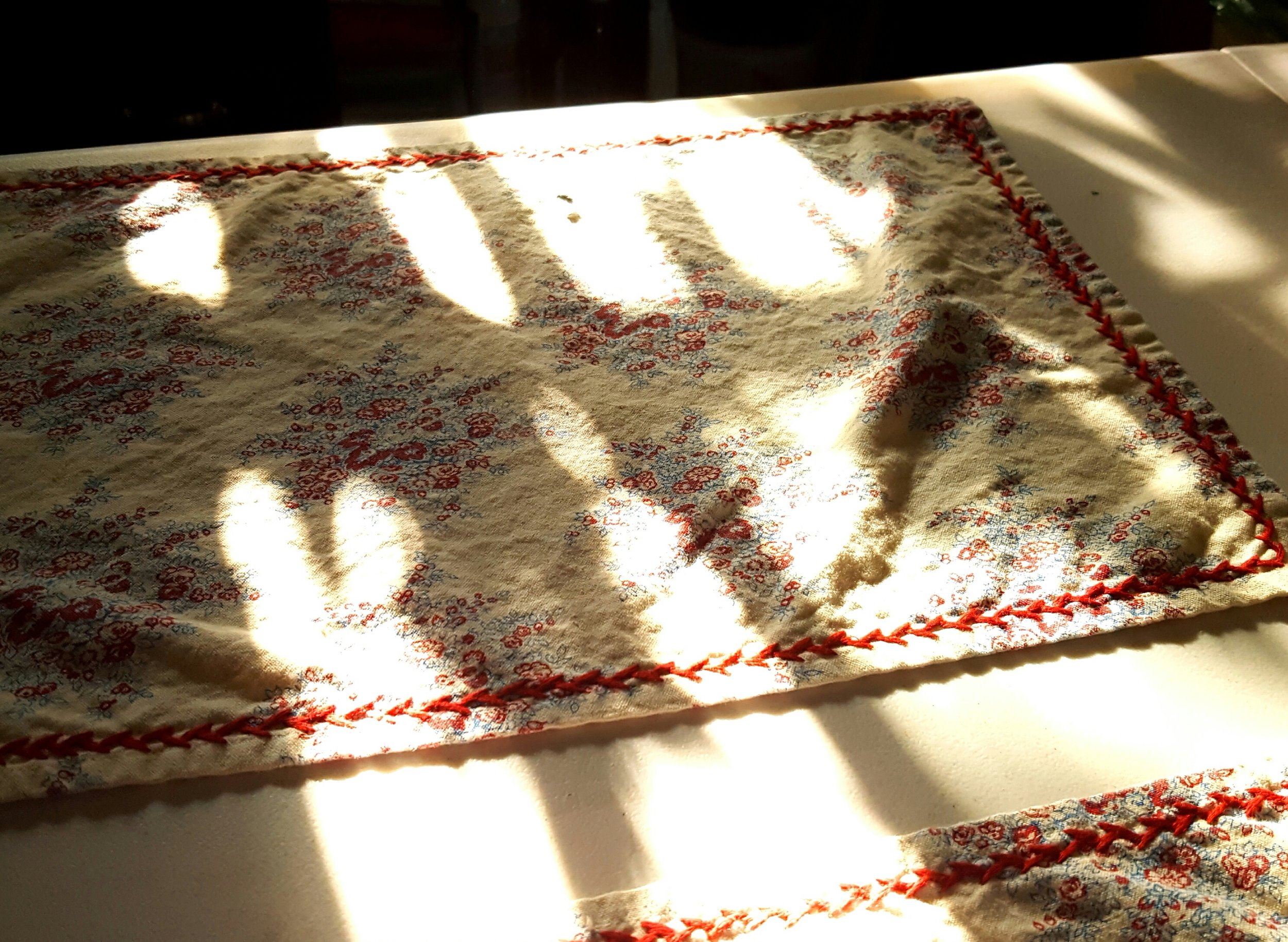 The morning sunshine leaving its dancing pattern on my table.