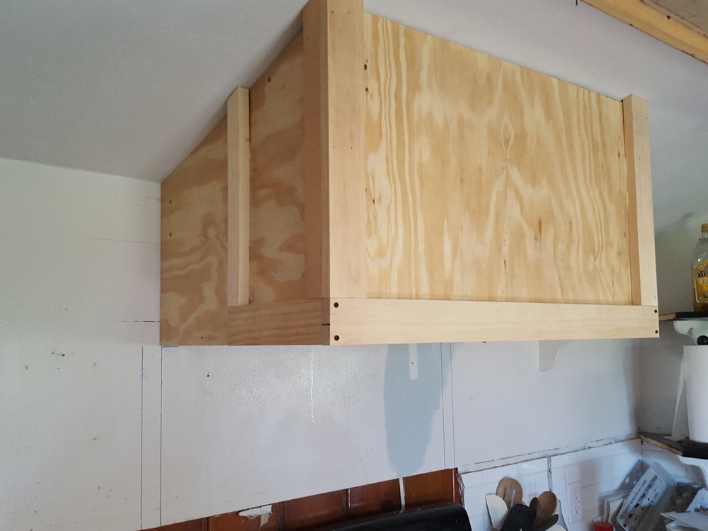 The Plywood base and trim for the reclaimed range hood cover.