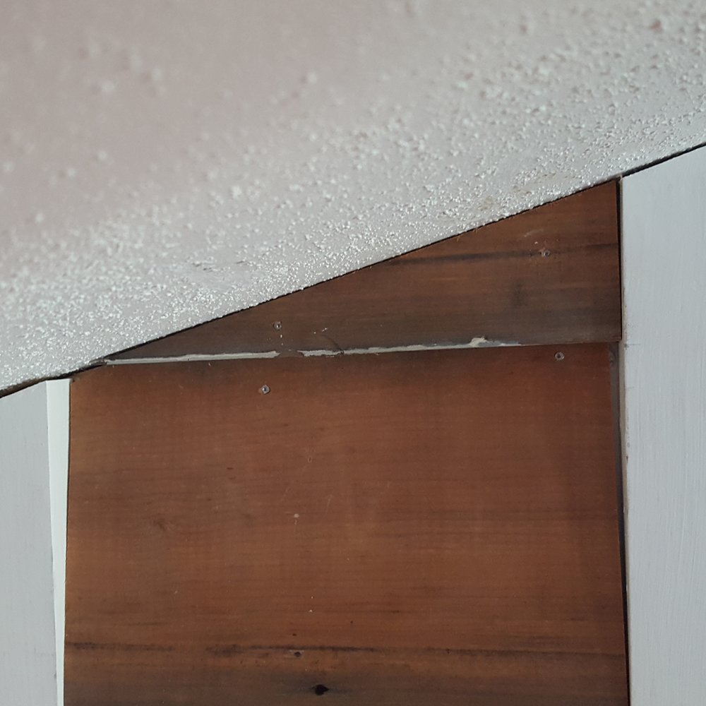 The angle piece of wood siding fit perfectly on the range hood cover.