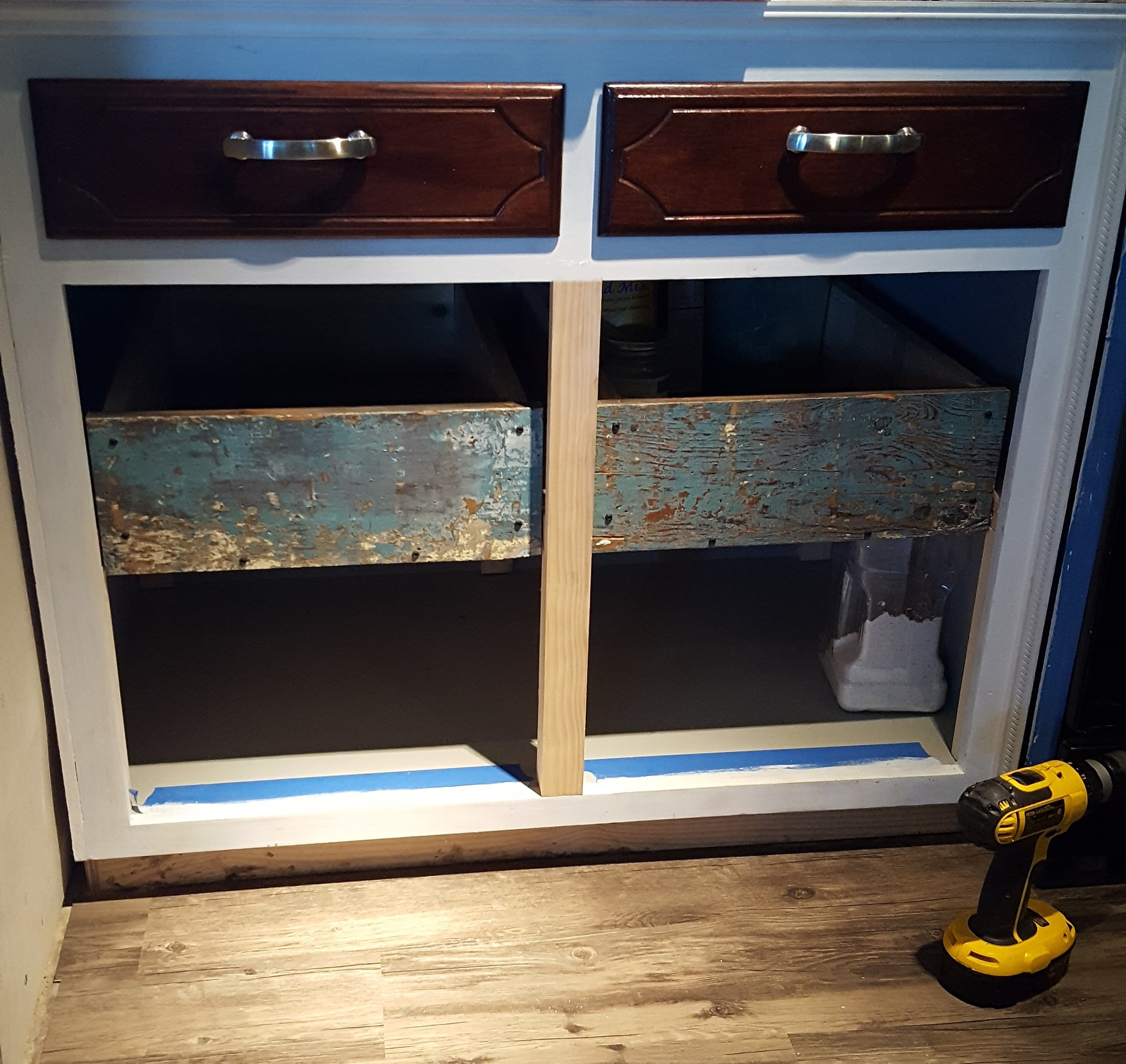 My gorgeous, reclaimed, blue-faced, pull out cabinet storage!