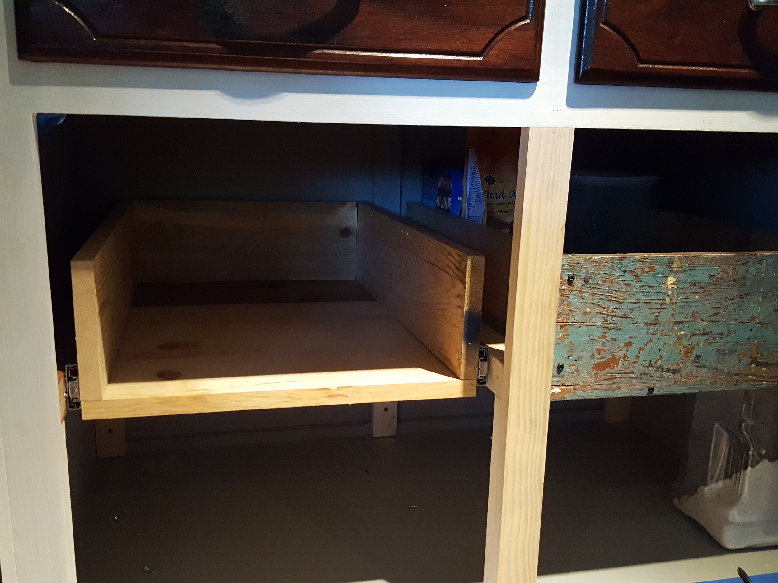 Pull out drawers minus their gorgeous reclaimed faces.