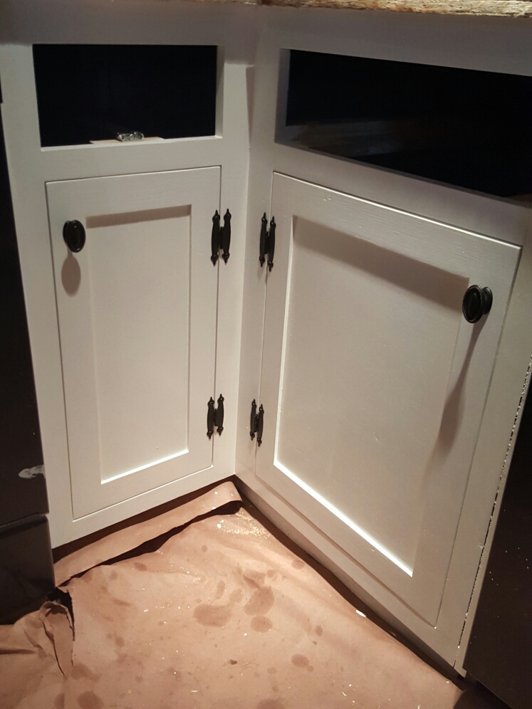 The diy farmhouse kitchen cabinet doors are a inset, shaker style door in Simply White by Benjamin Moore with black hardware.