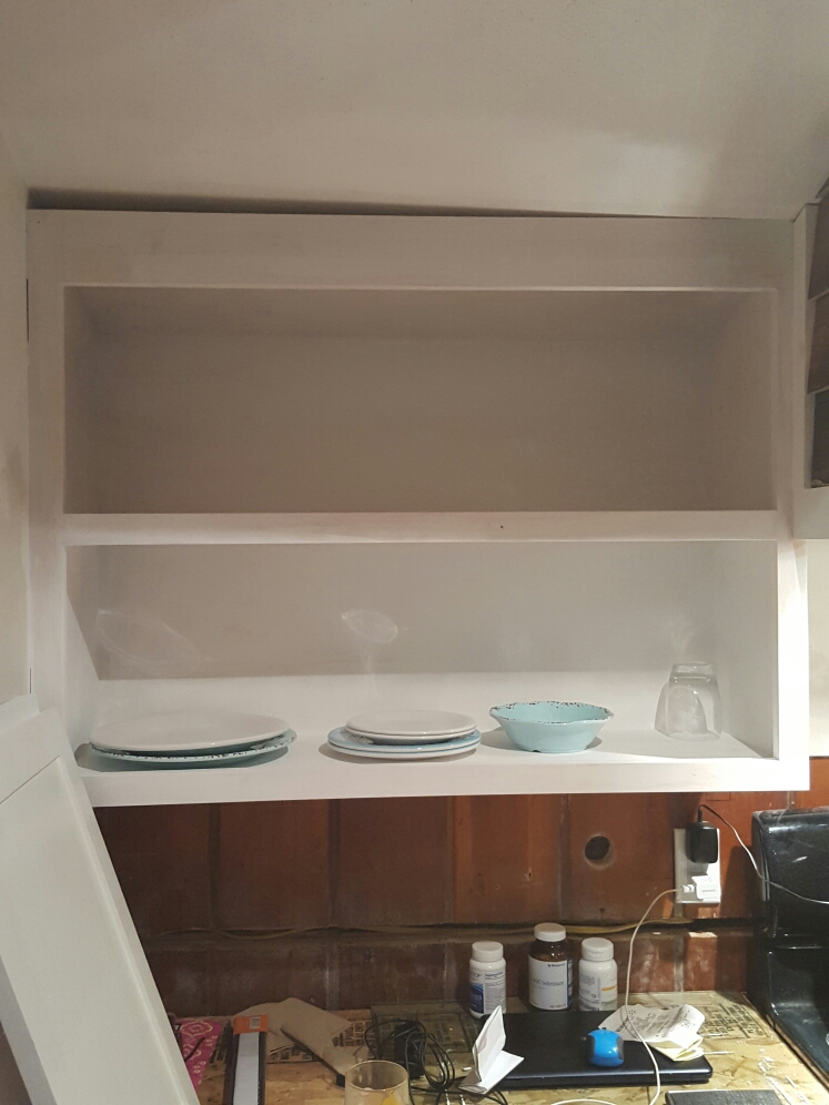 Out diy farmhouse kitchen cabinet was easy to build but hard to install.