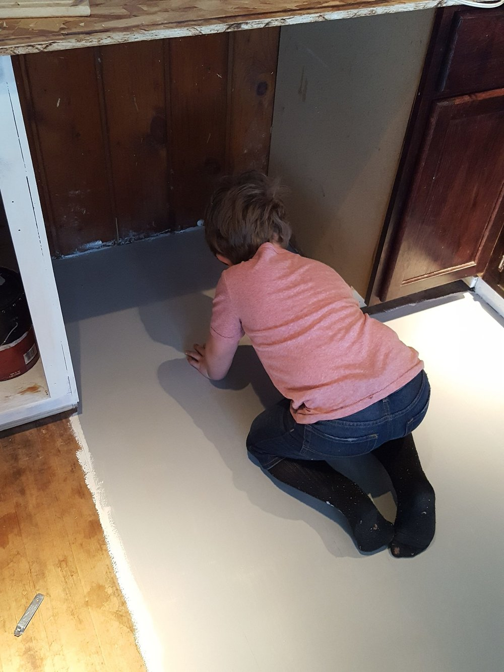 My helper with our gray kitchen floor.