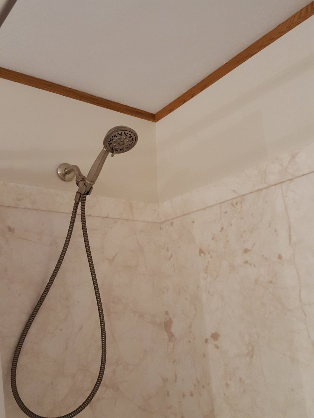 Handicap bathroom remodel - shower head and ceiling.