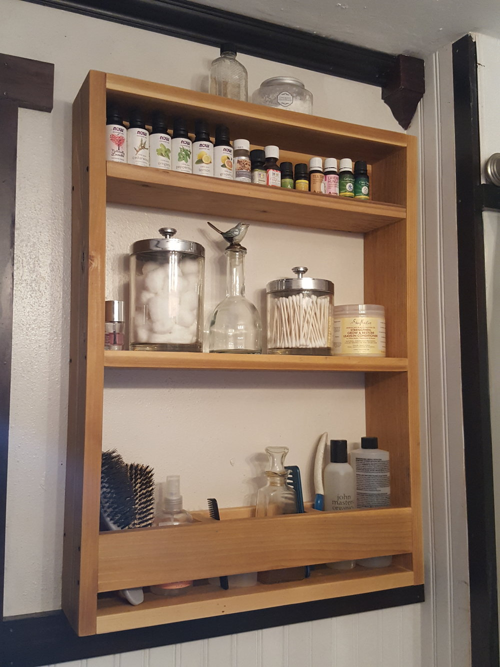 The 3rd shelf of my cedar bathroom storage is the perfect spot for my essential oils!