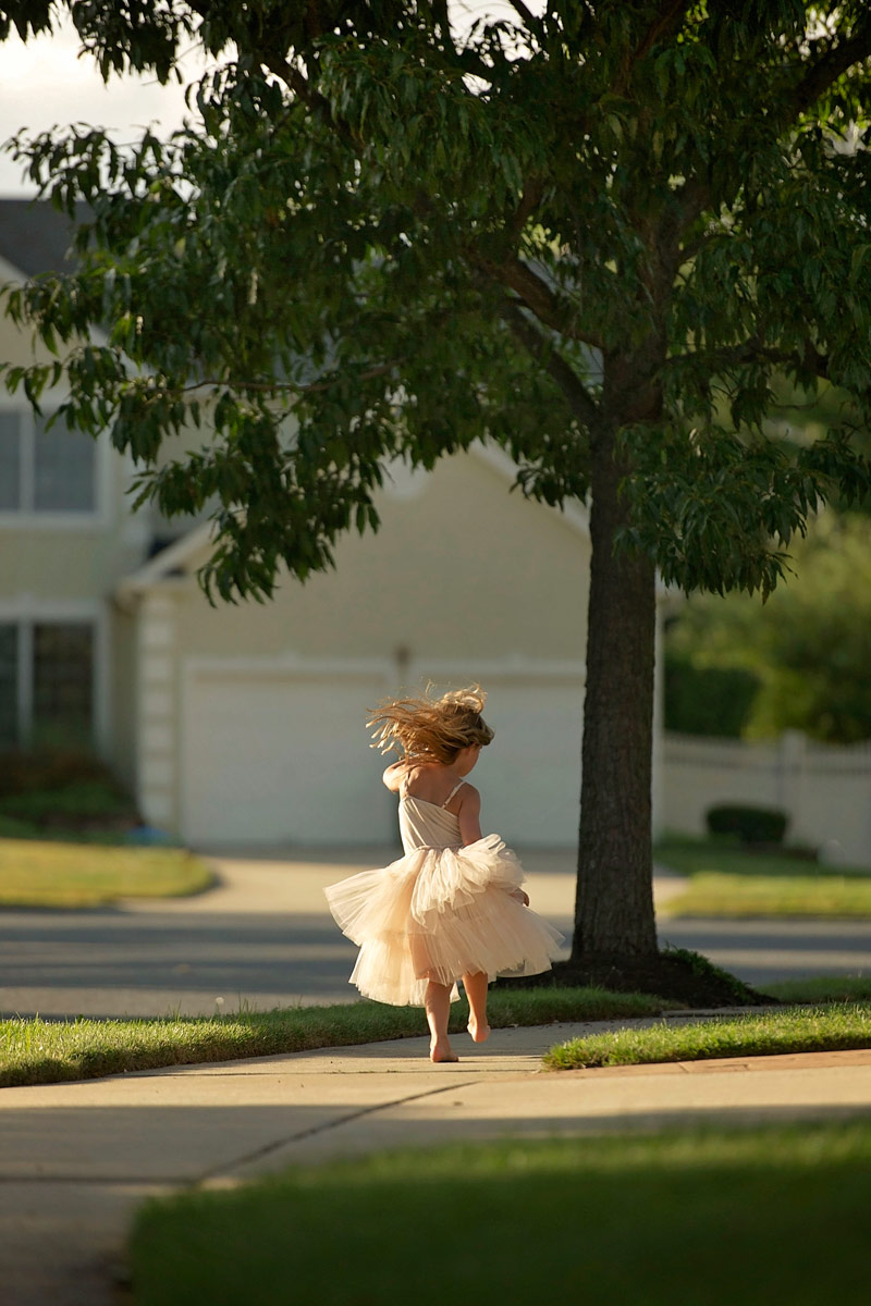 five year old running barefoot in tutu