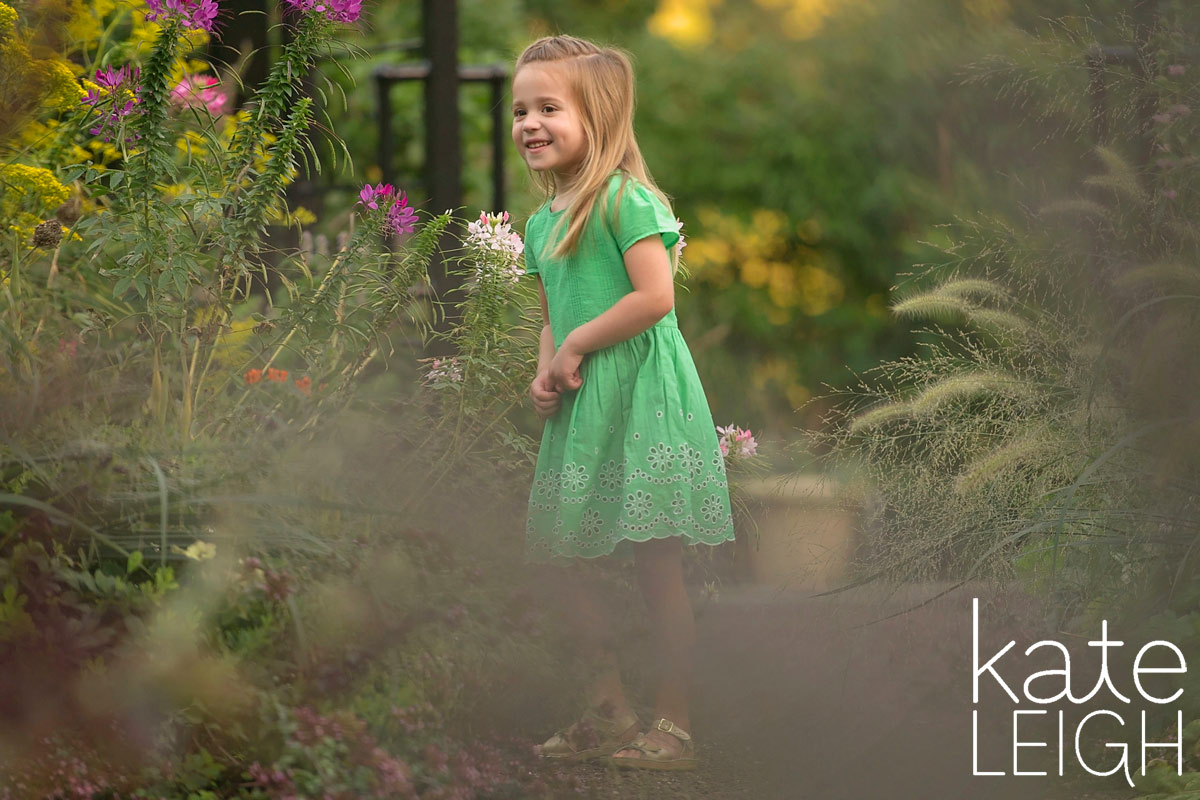 little girl in green dress at morris arboretum