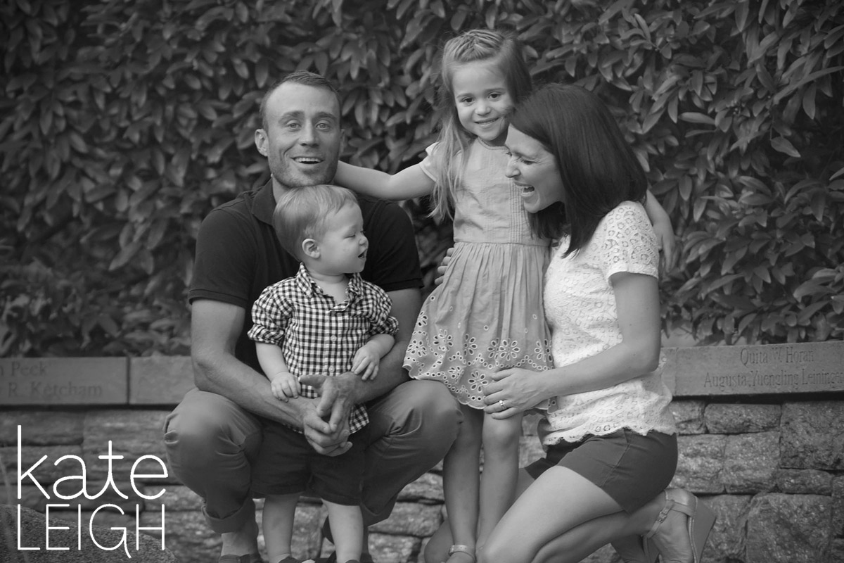 black and white of family smiling and laughing at Morris Arboretum