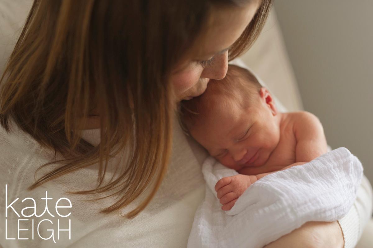 sleeping newborn on mother