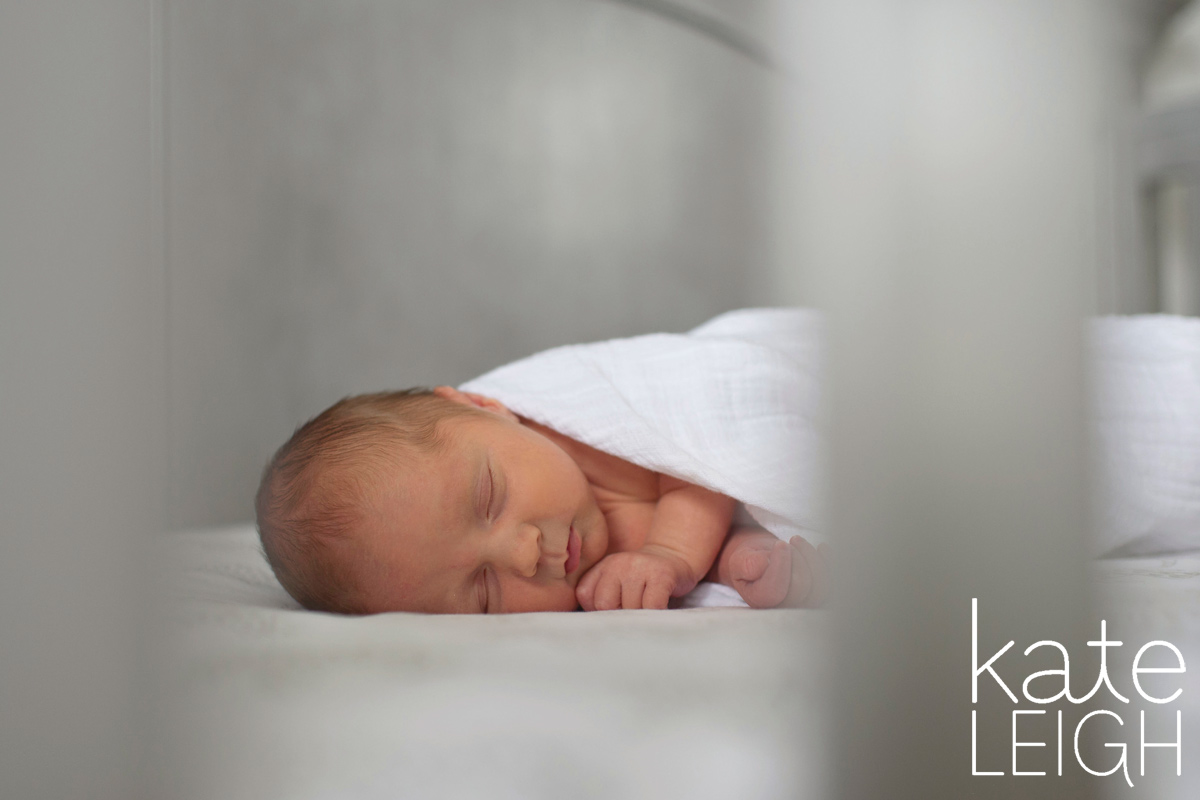 sleeping newborn in crib