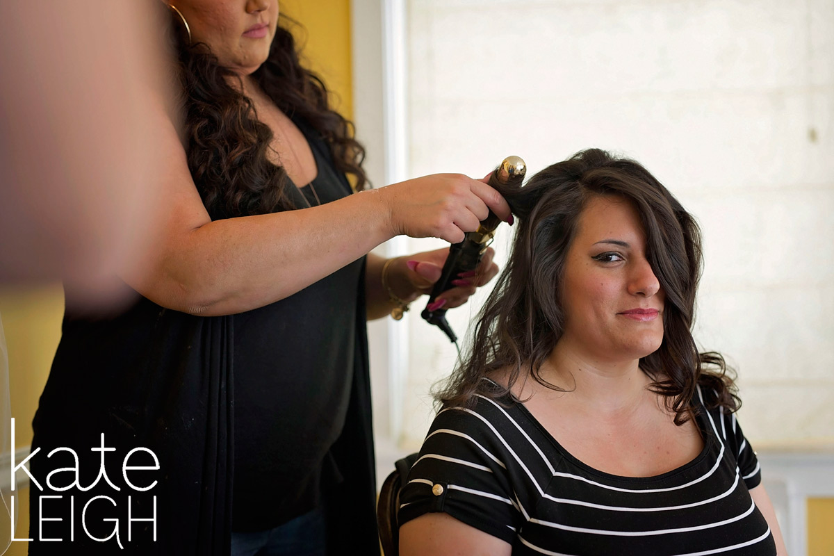 Bride getting her hair done for wedding at Silver Creek Country Club