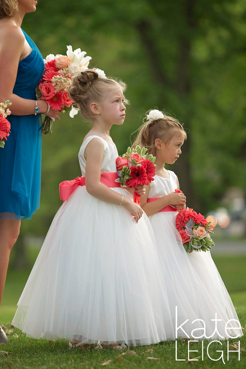 flower girls looking on at ceremony